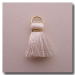 1-1744 Ivory Tassel w/Antique Gold Plate Jump Ring - 1/2